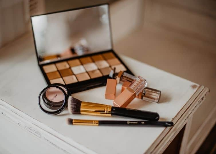 Various beauty tools and products arranged on a vanity