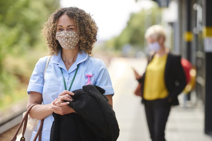 Nurse in facemask traveling due to demand in part-time and freelance nurses