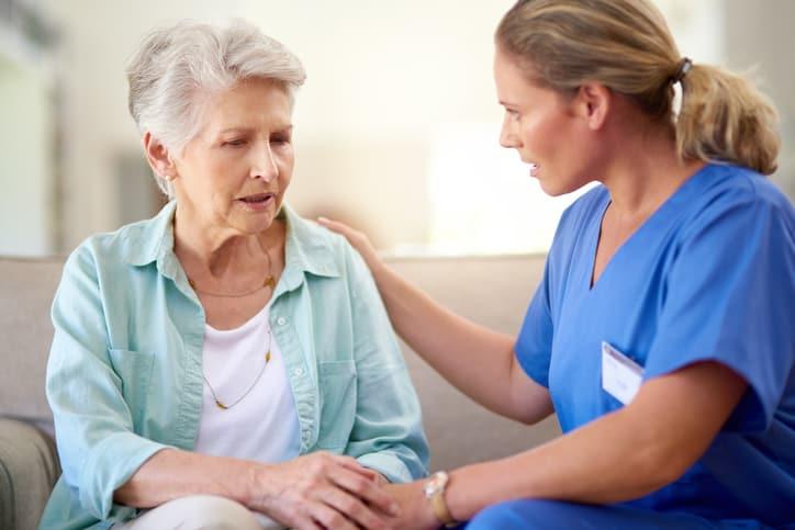 SANE nurse consoling a senior patient in a nursing home