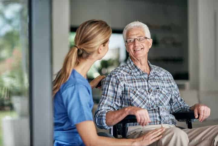 Shot of a senior man with Alzheimer's being assisted by his female nurse