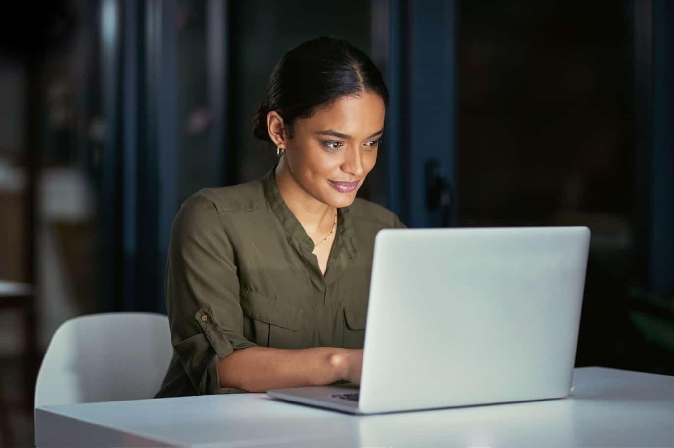 Nursing professional using laptop computer