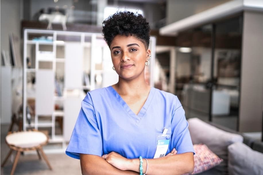 Confident, content nurse looking at camera with arms folded